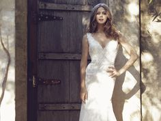 Luv Bridal Lace A-line wedding dress with v-neckline. #LuvBridal #lacewedding #weddingdress #romantic