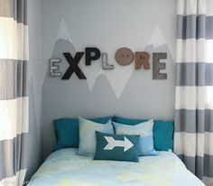 Little explorer boys bedroom with painted mountains. Love this boys bedroom theme!