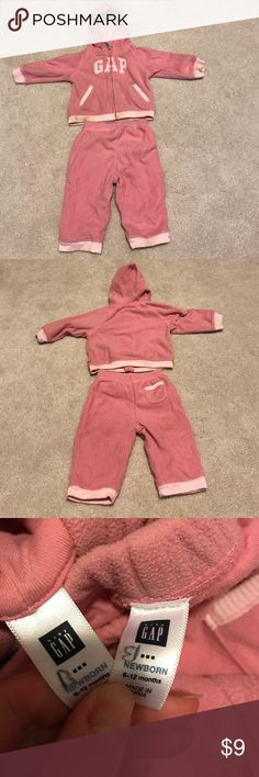 """Gap Pink fleece hoodie sweat pants girl size 6-12M Gap pink fleece hoodie and sweat pants matching set size 6-12 months. Some staining on bottom elastic band and the letter """"A"""" (pictured) might come out in wash. Otherwise in good condition. GAP Matching Sets"""