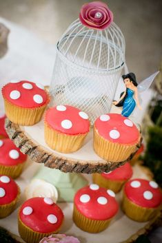 Toadstool cupcakes at a Tinkerbell fairies woodland birthday party! See more party planning ideas at CatchMyParty.com!
