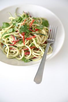 Vegan Asian Zucchini noodles - INGREDIENTS: Zucchini, onion, pepper, cilantro, sesame oil, lemon juice, soy sauce, agave syrup, raw peanuts  ginger.