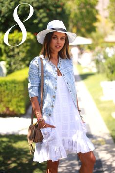 A denim jacket and little white dress are every festival goers must-haves.   - HarpersBAZAAR.com