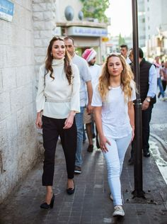 (R-L) Princess Iman of Jordan was refreshingly casual in blue jeans and a simple white t-shirt, while her mother Queen Rania of Jordan was elegant in black ankle skimming trousers and a white polo neck blouse, during the meeting with community groups who promote good citizenship.