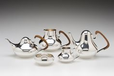"Henning Koppel (Danish, 1918-1981)/ Georg Jensen (Denmark) ""Tea and Coffee Set"" 1952 sterling silver, wood (coffee pot:) 6.25 x 9.75 x 5.5"" Photo: David H. Ramsey. 2006.106.1"