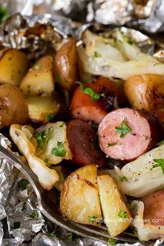 Cabbage and sausage foil packets are the perfect effortless easy meal! Tender potatoes, smoky sausage, onion and sweet cabbage seasoned with garlic butter and all cooked in a tidy little packet on the grill! Replace potatoes with radishes to make keto. Foil Packet Dinners, Foil Pack Meals, Foil Dinners, Foil Packets, Cabbage And Potatoes, Cabbage And Sausage, Best Cabbage Recipe, Cabbage Recipes, Grilling Recipes