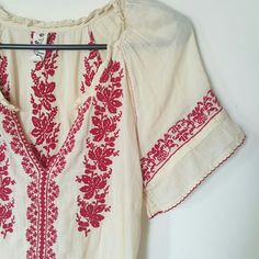 ❇HP❇ Gauzy Boho Peasant Top Beautiful cream colored top with red embroidery. Red tassel ties at waist, adjustable so you can have it form fitting or let it hang loose. The sleeves were gathered but I removed the elastic because it was uncomfortable. Perfect for Spring and Summer.  ➳ Excellent gently preloved condition with no rips, holes or stains. Elastic was removed from sleeves. As is.  メ No holds  メ No trades メ Poshmark only Reasonable offers ♡ Tops Blouses