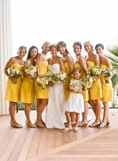 Cheerful yellow with matching bouquets and shoes. Love the flower girl dress - modern and fun