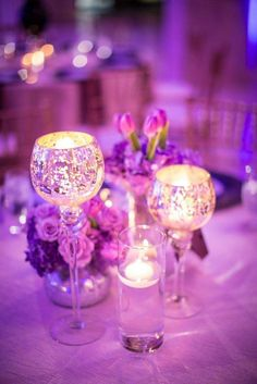 """This ultra glam Atlanta wedding planned and designed by Lemiga Events is, without a doubt, the highlight of my day! """"Ashlynn and Terrell decided on a Hollywood Glam theme for their wedding at 200 Peachtree,"""" said Wedding Planner Michelle Gainey of Lemiga Events. Featuring grand chandeliers and tall ceilings, 200 Peachtree provided the perfect backdrop for a celebration of this caliber. Lemiga Events used a bold color scheme of purple, silver, champagne, and black to achieve the luck..."""