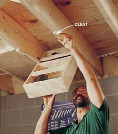Why waste rafter space?  Try hinging one of these at one end, then putting plexiglass over the middle.  Drop canned food in the top and retrieve it from the bottom!