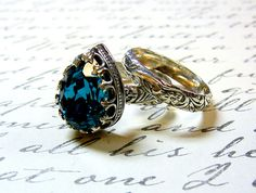 Gothic Medieval Vintage Sterling Silver Blue Zircon Swarovski Crystal Ring with matching Floral Band. $145.00, via Etsy.