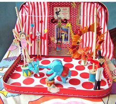 A circus in a suitcase. Could be translated to other toys e.g dolls, trains, cars, animals