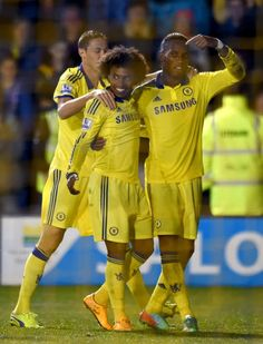Drogba celebrates with Willian and Matic