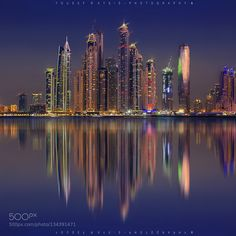 The Urban Pulse One Beautiful blue hour in Dubai last year. Taken from the amazing palm island. This photo features the tallest block in the world including Cayan tower and The Princess Tower.  Enjoy  feel free to share :D