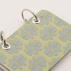 gorgeous mini journals using cardboard, fabric cover, binder rings, found paper