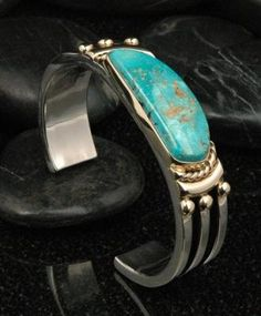 Great looking Turquoise Mountain stone sit in a heavy silver cuff. I'd wear this...