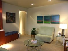 Original oil on canvas paintings elevate a dermatologist waiting room.