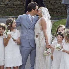 Jamie Hince and supermodel Kate Moss, wearing John Galliano, posed for a kiss following their July 1, 2011 wedding ceremony in England.