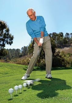 GET STARTED: To gain a sense of swinging the club with support from your feet and legs, begin by hitting a line of balls in a continuous motion.