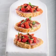 Make this Shaved Country Ham Bruschetta recipe, which uses fresh tomatoes, garlic and country ham.