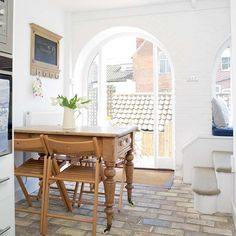 The beautiful window in this kitchen remains the focal point of the space thanks to the simple decor Kitchen Seating, Kitchen Dining, Bedroom Dressers, Coastal Style, Home Organization, House, Inspiration, Window, Furniture
