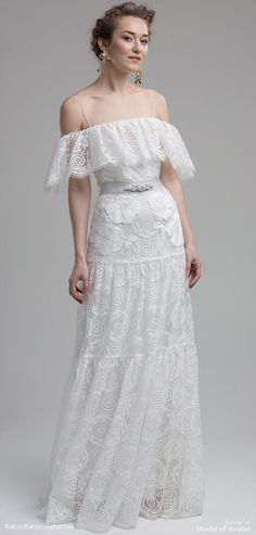 The floral detailing captured throughout the exquisite lace adds a feminine flourish to the bridal gown. This off-shoulder stunning dress echoes romance, joined together by a peplum silhouette and luxurious embellished sash, channels a stylish and dreamy vibe. Beautifully light and breathable gown for those glorious summer days.
