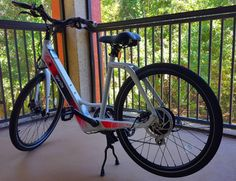 Comparing GenZe Electric Bicycle & BMW i3 — Seriously National Bike Month, Folding Cart, E Bicycle, Bmw I3, Nissan Leaf, Electric Bicycle, Back Seat, Electric Push Bike