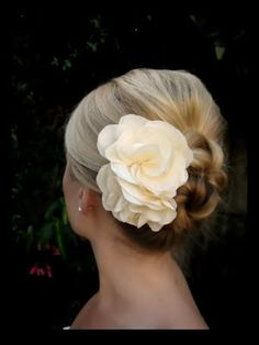 I love this flower:  http://www.etsy.com/listing/62695041/camille-white-color-dupion-bridal-hair