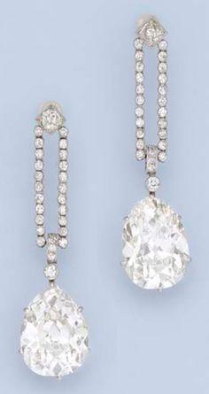A PAIR OF IMPORTANT BELLE EPOQUE EAR PENDANTS, CIRCA 1910. Each designed as a detachable pear-shaped diamond drop weighing 9.49 and 9.51 carats to the collet-set diamond twin-line surmount, each 4.9 cm. long. #BelleÉpoque #earrings