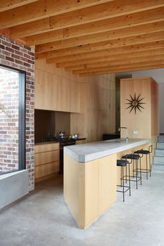 The new spaces hint at an industrial aesthetic, with an exposed roof structure and plywood and concrete surfaces. Plywood Kitchen, Concrete Kitchen, Brick Interior, Interior Design Kitchen, Scandinavian Kids Rooms, Latest Kitchen Designs, Vertical Garden Design, Exposed Brick Walls, Kitchens