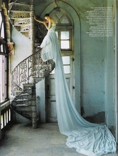 spiral staircase  I want to paint my living room and kitchen this shade of sheer blue. Her dress is so translucent. I want the walls to appear to be leaking light from outside.