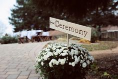 ceremony sign and potted mums as fall wedding decor | photo: www.carissachristine.com