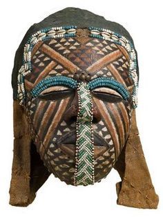 Africa | Ngady aMwaash Mask, (Female Mask) Kuba Peoples, Democratic Republic of the Congo, 19th–20th century, Materials;   Wood, cloth, pigment, beads, cowrie shells | Neuberger Museum of Art; Gift of Lawrence Gussman