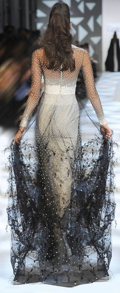 Georges Chakra - sheer with fear like crafted patterns along the base