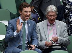 Give us a wave! Benedict Cumberbatch, sat next to dad Timothy, acknowledges a fired-up crowd at Wimbledon ahead of the Men's Singles final
