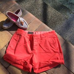 J. Crew broken in boyfriend shorts sz 8 red Cotton button fly. City fit- sits just above your hip. 7 1/2 inch inseam unrolled , and 5 inches rolled. Color is a lighter red. Not orange, but a brighter red.  Excellent condition!! Worn once! J. Crew Shorts Bermudas