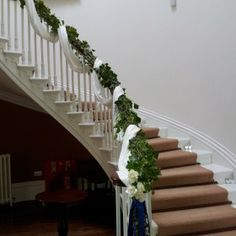 River Hall - The Big Cottage Company - Kate & Tom's - Curving floral staircase at River Hall in Bideford, North Devon