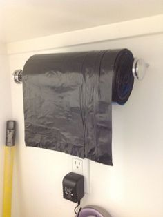 Smart! Paper towel holder for trash bags on a roll .