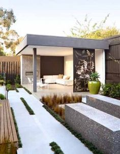 Nice contrast of concrete and grass with corner shelter | adamchristopherdesign.co.uk