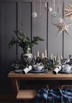 Christmas in our Nordic Folk trend - decorate your kitchen and living room space with neutral and grey dining sets, shimmering baubles and gold stars!