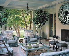 Great porch space. Like the outdoor fireplace. Probably backs onto an inside fireplace. Like the blue ceiling with white trim.