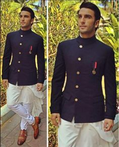 There is nothing that #RanveerSingh can't pull off. Is there? Spotted in @shantanunikhil's men's couture. #MensWear #MensCouture #Mensfashion #malefashion #traditional #indian #indowestern #navyblue #brooch #bollywood #fashionbloggers #fashionaddicts #actor #indian #buttons #poser #edgy