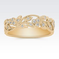 This spectacular 14 karat yellow gold design features unique milgrain detailing and 21 round pavé-set diamonds, at approximately .16 carat total weight.  Each diamond has been hand-matched for maximum color and clarity.