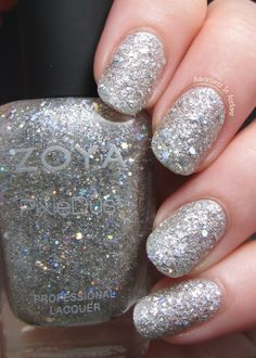 Zoya Cosmo: a silver crystal sparkle, textured PixieDust with mega hex holographic glitter.  Showing 2 coats with no top coat.