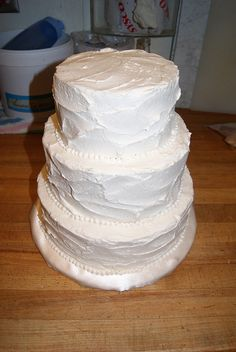 Simple....just needs a little decoration and our cake topper...Wedding Cake by How Sweet It Is Cakes in Duluth, MN, via Flickr