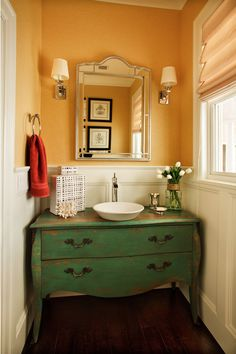 yellow wall, green vanity, chrome accents