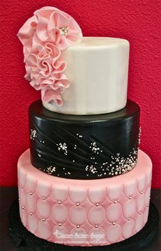 White-black-pink wedding cake embellished with silver pearls and ruffles!  www.gimmesomesugarlv.com  #coutureweddingcakes #ruffles #customcakes