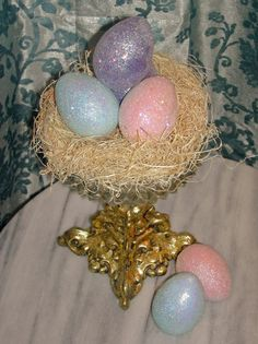Get Your Glitter on - shimmering eggs in a nest of excelsior - lovely centerpiece