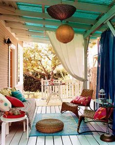 Outdoor patio idea - curtains and hanging lights, perhaps a bunching, made from old parasols?