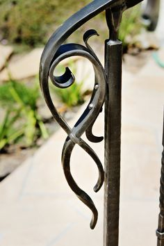 Ornate rail termination on outdoor rail Wrought Iron Stair Railing, Wrought Iron Decor, Metal Stairs, Wrought Iron Gates, Railings, Iron Handrails, Forging Metal, Iron Art, Metal Projects