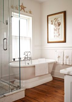 Tub: Billie Brenner Ltd., 617/348-2858, billiebrennerltd.com.         Fixtures, farmhouse sink (by Shaw): Rohl, 800/777-9762, rohlhome.com.         Botanical: Lexington Gardens, 212/861-4390, lexingtongardensnyc.com.